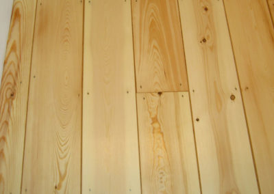 After - pine tongue and groove floorboards with gaps filled