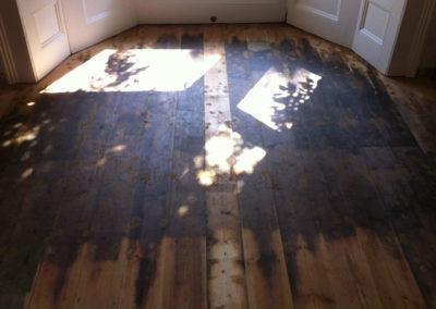 Before - hardwood floor in poor condition