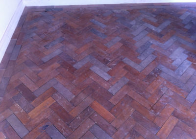Before - oak parquet was restored with various shades