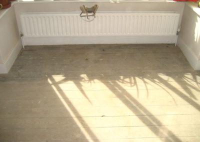 Before - pine floorboards