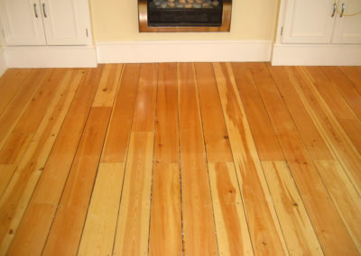 Before -pine tongue and groove floorboards over 6 years old
