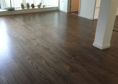 Douglas fir pine solid floorboards stained and satin finished